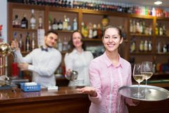 Nippy with beverages and bar crew. Smiling  american nippy with beverages and bar crew at background Stock Images