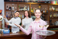 Nippy with beverages and bar crew. Smiling nippy with drinks and bar crew at background Royalty Free Stock Photography