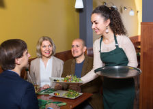 Nippy serving table with adults. Nippy serving table with happy adults in restaurant Stock Photo