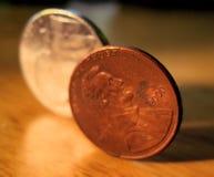 Niquelar e moeda de um centavo Fotografia de Stock