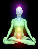 Nirvana. 3D illustration of woman meditating and energizing her energy centers  through the lotus position Stock Photo