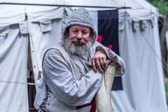 Portrait of old Templar Knight with beard and hood royalty free stock photo