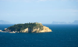 Nisida Island. Nisida, a small island in the gulf of Pozzuoli (Napoli) and in background Sorrento peninsula and Capri island royalty free stock photo