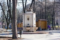 Niska Banja,Serbia-February,18.2019: Monument to the king Milan Obrenovic in central park, memorial fountain. Niška Banja Serbian Cyrillic royalty free stock photo