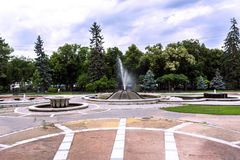Big park in spa resort with fountain and walking path royalty free stock photo