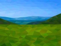 Niskie poli- góry z niebieskim niebem Obrazy Royalty Free
