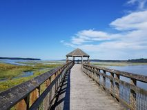 Nisqually boardwalk estuary trail gazebo. Located at Billy Frank Jr. Nisqually National Wildlife Refuge in Olympia, Washington. This Gazebo offers a scenic view Royalty Free Stock Photos