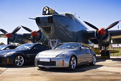 Nissan 350Z Convertible and Hard Top. Japanese sports coupe. Nissan 350Z convertible & hard top, parked in front of a vintage war plane. [Avro Shackleton MkIII Royalty Free Stock Images