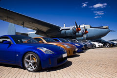 Nissan 350Z - Range of Colours. Japanese sports coupe. Nissan 350Z convertible & hard top, parked in front of a vintage war plane. [Avro Shackleton MkIII] Royalty Free Stock Images
