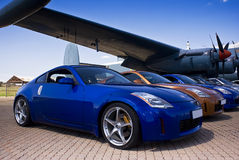 Nissan 350Z - Range of Colours. Japanese sports coupe. Nissan 350Z convertible & hard top, parked in front of a vintage war plane. [Avro Shackleton MkIII] Stock Photography