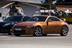 Nissan 350Z Z33 - Gold. Japanese sports coupe. Nissan 350Z, Z33 Touring, automobile Royalty Free Stock Photos