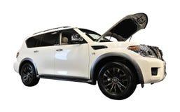 Nissan Armada op Witte Achtergrond stock fotografie
