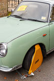 Nissan Figaro classic car with yellow triangle wheel parking cla Stock Photo