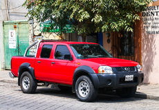 Nissan Frontier. OAXACA, MEXICO - MAY 25, 2017: Red pickup truck Nissan Frontier in the city street stock photos