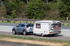 Nissan Juke with a Caravan Stock Photography