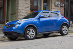 2015 Nissan Juke Sedan Blue. 2013 Nissan Juke.  Four door model with sporty wheels and bright blue exterior Royalty Free Stock Photography