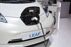Nissan Leaf and charging station Stock Photos