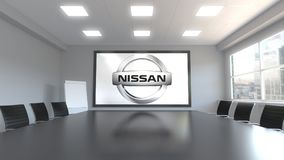 Nissan logo on the screen in a meeting room. Editorial 3D rendering. Nissan logo on the screen in a meeting room. Editorial 3D Royalty Free Stock Photography