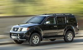 Nissan Pathfinder. Nissan Pathfinder black car on a blurred background Royalty Free Stock Image