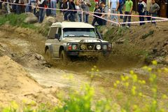Nissan patrol during mud passage. Off-road Competition just started Royalty Free Stock Images