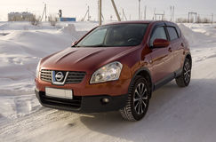 Nissan Qashqai in red color. This is crossover that combines modark design and compact hatchback refinement with functionality Stock Photography