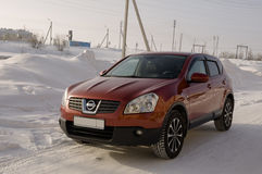 Nissan Qashqai in red color. This is crossover that combines modark design and compact hatchback refinement with functionality Royalty Free Stock Photos