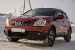 Nissan Qashqai in red color. This is crossover that combines modark design and compact hatchback refinement with functionality Royalty Free Stock Image