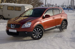 Nissan Qashqai in red color. This is crossover that combines modark design and compact hatchback refinement with functionality.  Royalty Free Stock Photo