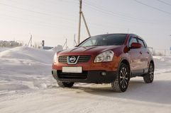 Nissan Qashqai in red color. This is crossover that combines modark design and compact hatchback refinement with functionality Royalty Free Stock Images
