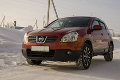 Nissan Qashqai in red color. This is crossover that combines modark design and compact hatchback refinement with functionality.  Stock Photography