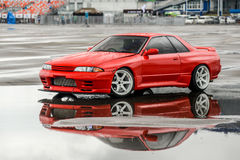 Nissan skyline R 32 red color on a wet road Stock Images
