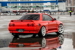 Nissan skyline R 32 red color on a wet road royalty free stock images