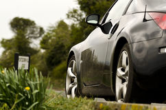 Nissan Sports Car Country Road. Black sports car Nissan 350z Country Road Royalty Free Stock Photo