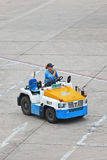 Nissan tow tractor for baggage dolly transport on Beijing Capital International Airport. Royalty Free Stock Images