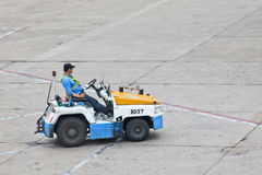 Nissan tow tractor for baggage dolly transport on Beijing Capital International Airport. BEIJING-MAY 23. 2014. Nissan tow tractor for baggage dolly transport on stock photography