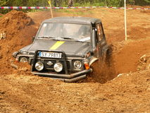 Nissan in trouble. Nissan patrol stuck in the mud Royalty Free Stock Photos