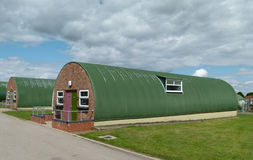 Nissen Huts. Two Nissen huts - part of a row of intact survivors of 1940s British military architecture Stock Photography