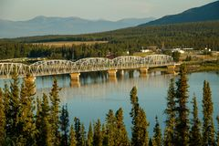 Nisutlin Bay bridge in Teslin in Yukon north territory. Larger then life, Teslin bridge on Alaska HWY, Yukon, Canada, road trip to Alaska land, Alaska stock photo
