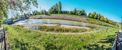 Nitra river with hydroelectric power plant, panorama royalty free stock photos