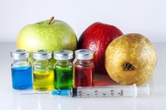 Nitrates and fruit. Against the backdrop of fruit jars, a syringe with nerats Stock Images