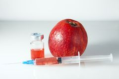 Nitrates and Green Apple. Syringe and jars filled with nitrates lie on the background of an apple Stock Photo