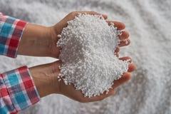 Nitrogen fertilizers or urea fertilizer. In farmer hand. blur white fertilizer background royalty free stock images