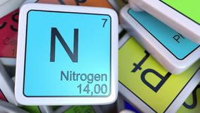 Nitrogen block on the pile of periodic table of the chemical elements blocks. Chemistry related 3D rendering. Nitrogen tag on the pile of periodic table of the Stock Image