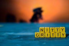Nitty - zanderig op houten blokken Kruis verwerkt beeld met bokehachtergrond stock foto