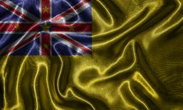 Wallpaper by Niue flag and waving flag by fabric. stock photos