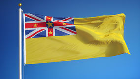 Niue flag in slow motion seamlessly looped with alpha. Niue flag waving in slow motion against clean blue sky, seamlessly looped, close up, isolated on alpha stock video footage