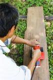 Nivå för trä för manbruk elektrisk Arkivbilder