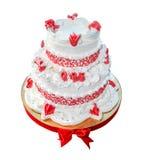 Nivåer för bröllopstårta som två isoleras på vit bakgrund arkivbild