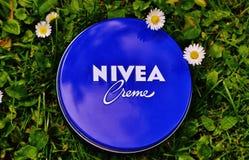 Nivea Creme Tub on Grass Royalty Free Stock Photo