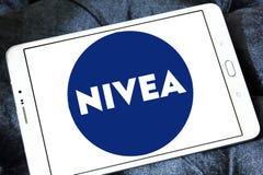 Nivea logo. Logo of beauty and cosmetics company nivea on samsung tablet stock photos